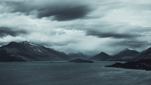 Mountains with sea and dark, cloudy sky