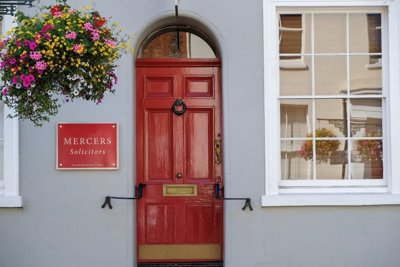 Mercers Solicitors sign and red door