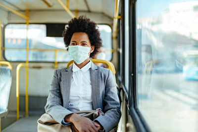 woman on bus wearing face mask